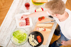 Young man preparing a Sandwich Stock Photo