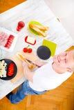 Young man preparing a Sandwich Stock Photos