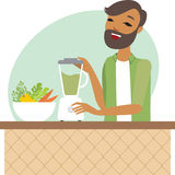 Young man preparing smoothie Royalty Free Stock Images