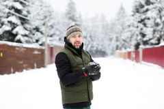 Young man preparing a snowball Royalty Free Stock Images