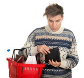 Young man preparing to pay in shop Royalty Free Stock Images