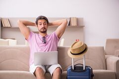 Young man preparing for trip at home