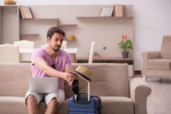 Young man preparing for trip at home during pandemic