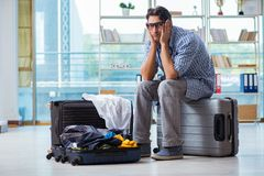 The young man preparing for vacation travel. Young man preparing for vacation travel Royalty Free Stock Photo