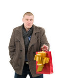 Young man with present bag Royalty Free Stock Photos