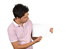 Young man presentation. Young man  making a presentation on a blank page isolated on white background,check also People with blank sign Stock Photos