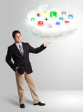 Young man presenting cloud with colorful app icons and symbols Stock Image