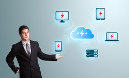 Young man presenting cloud computing network Royalty Free Stock Image