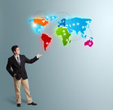 Young man presenting colorful world map Stock Image