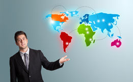 Young man presenting colorful world map Stock Photography