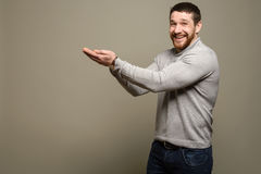 Young man presenting. copy space for your text Royalty Free Stock Image