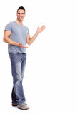 Young man presenting a copyspace. Stock Photography