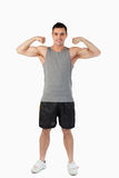 Young man presenting his muscles Stock Photo