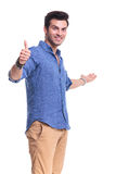 Young man presenting and making ok sign Stock Image