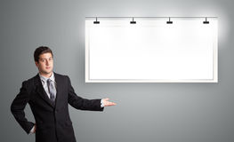 Young man presenting modern copy space Royalty Free Stock Image