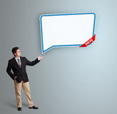 Young man presenting modern speech bubble copy space Royalty Free Stock Photos