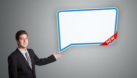 Young man presenting modern speech bubble copy space Royalty Free Stock Image