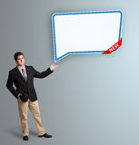 Young man presenting modern speech bubble copy space Royalty Free Stock Photo