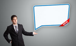 Young man presenting modern speech bubble copy space Royalty Free Stock Images