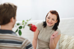 Young man presenting red rose to girlfriend Royalty Free Stock Photography