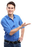 Young man presenting something. Young man over white background Stock Photo