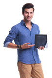Young man presenting a tablet computer. On white background Royalty Free Stock Image