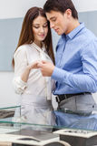 Young man presents engagement ring to his girl Royalty Free Stock Image