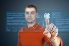 Young man pressing digital button Royalty Free Stock Images