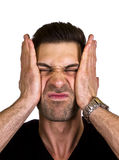Young man is pressing his face Royalty Free Stock Images