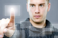 Young man pressing a touch button Stock Images