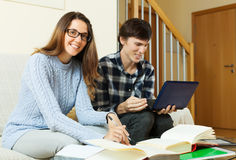 Young man and pretty woman prepare for exam Royalty Free Stock Photography