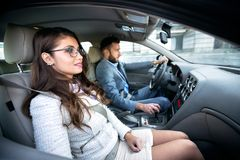 Young man and a pretty woman. Young men and a pretty women driving in the car stock images