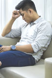 Young man with problems and stress at home Stock Images