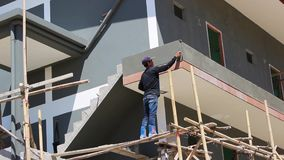 Young man produces plastering on construction stock footage