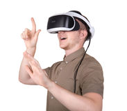 A young man with professional audio equipment, isolated on a white background. Surprised guy with VR goggles. stock photos