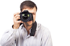 Young man with professional camera Stock Images
