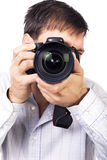 Young man with professional camera Royalty Free Stock Image