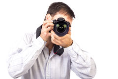 Young man with professional camera Royalty Free Stock Photos