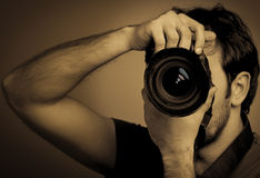 Young man with professional camera. Monochrome Royalty Free Stock Photo