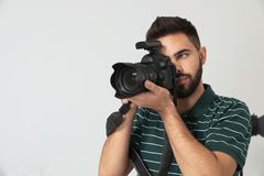 Young man with professional camera in studio. Space for text. Young man with professional camera in photo studio. Space for text royalty free stock photos