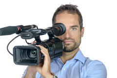 A young man with professional movie camera Royalty Free Stock Photography