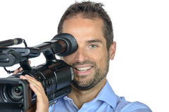A young man with professional movie camera Stock Photos