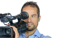 A young man with professional movie camera Royalty Free Stock Image