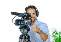 Young man with professional movie camera Royalty Free Stock Image