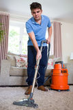 Young Man Professionally Cleaning Carpets royalty free stock images