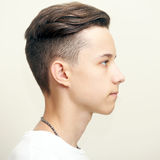 Young man profile face over gray Royalty Free Stock Photography