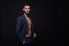 Young man profile, suit elegant, copy space. Young adult man, profile, elegant suit blue jacket, shirtless abs muscle fit, copy space stock images