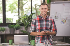 Young Man Programmer Computer Technology Work Concept. Young man programmer standing in the office professional employee Royalty Free Stock Photography
