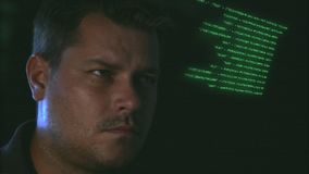 Young Man and Programming Code Running stock footage