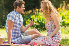 Young man propose to girlfriend Royalty Free Stock Photography